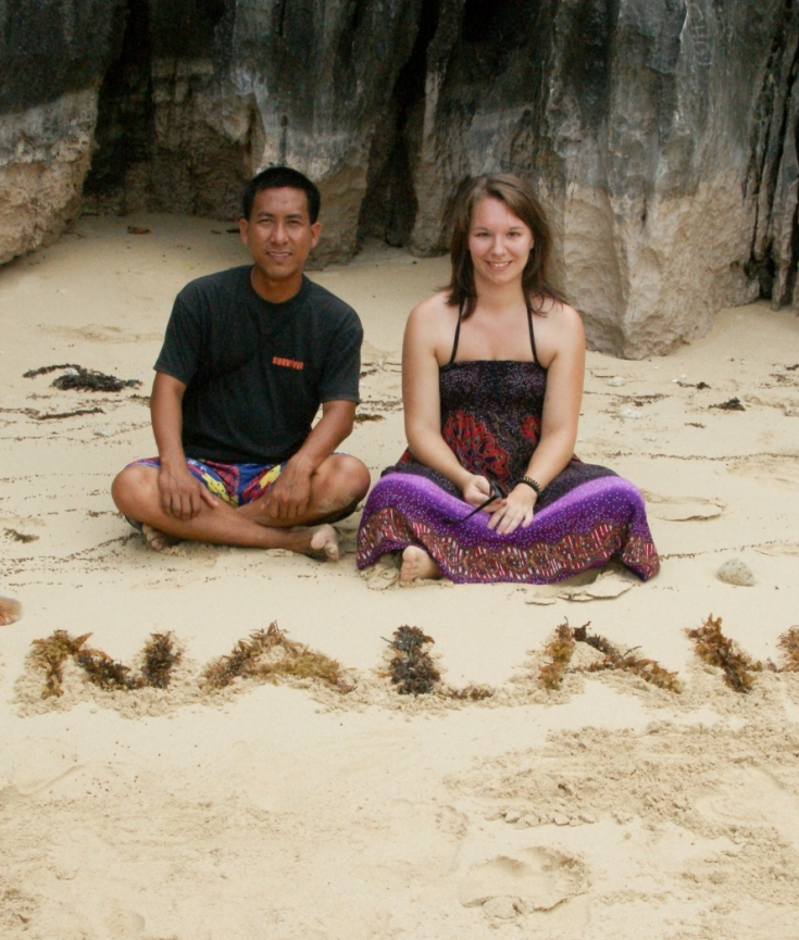 Photo - My 3 friends write the name of each island into the sand and are so happy to take pictures!